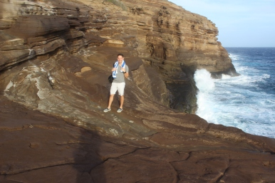 Josh and the waves crashing on the rocks. Cool picture.
