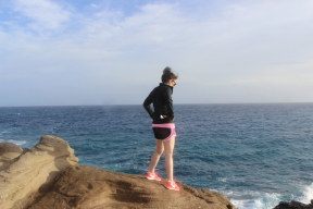 Me admiring the waves crashing on the rocks.