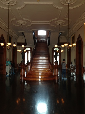 The main staircase constructed of koa wood with kamani and walnut trim.