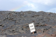 I thought this was hilarious. The road closed sign buried in lava...with a rainbow as the backdrop.