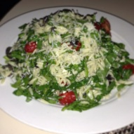 Orzo, spinach, tomato, olives, feta, capers, parmesan, pine nuts, lemon.