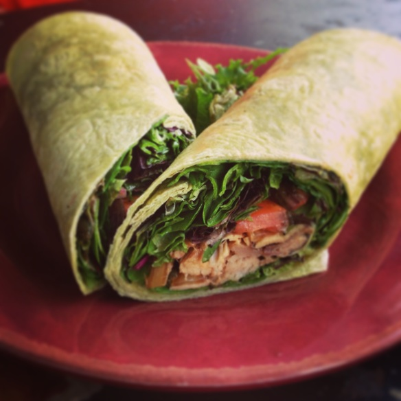 Fresh fish, lettuce, Molokai tomatoes, dressing in a spinach wrap.