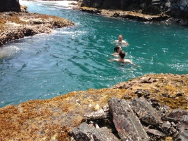 Becca, Ben and Josh swimming at an inlet on Moku Nui Island.