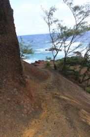 Trail to the red sand beach.