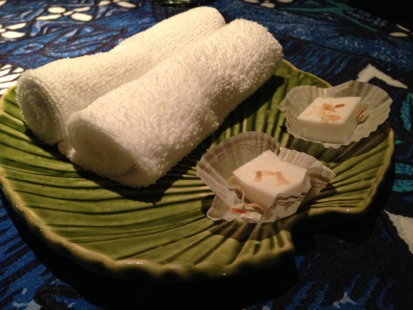 After dinner towels and a mini coconut dessert.