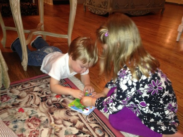 Olivia and Owen playing with the puzzle.