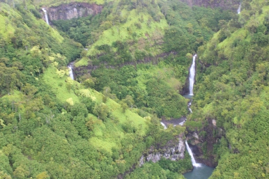 Five waterfalls that pour into Manawaiopuna Falls.