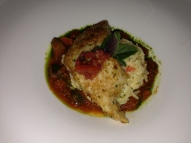 Opah fish with risotto and vegetables.