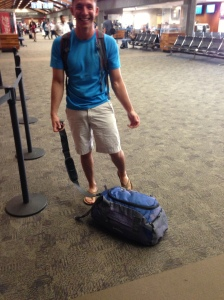 Josh and his disintegrated bag in the Maui airport.