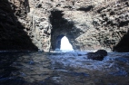 This cave was open on the top. Years of erosion from the water hitting the top of the cave made it fall in.