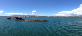 The panoramic of the ship. The white buoy marks the end of the ship.