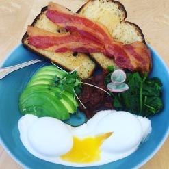 Brunch Bowl: avocado, soft eggs, house made yogurt, spinach, tomato jam, candied bacon, microgreens