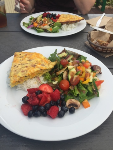 Bacon, onion, cheese frittata with garden salad and mixed berries