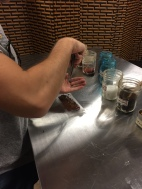 Josh adding coffee, cinnamon, and salt to his chocolate.