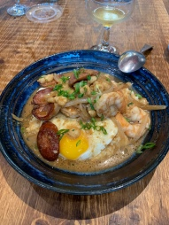 CREOLE SHRIMP N' GRITS andouille + hominy + red eye gravy + stoned ground grits