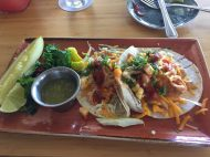 Island Fresh Fish Tacos: cheddar cheese, ancho chile crema, taco sauce, topped with tropical fruit salsa