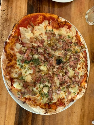 Florentine Pizza: tomato sauce, potatoes, onions, bacon, cheese, parmesan, garlic