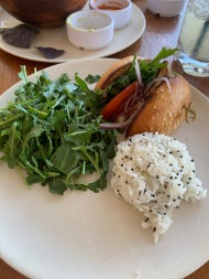 Local Fish Sandwich: tomato, onion, arugula, kalamata olive aioli with white rice & black quinoa